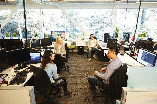 googlers talking in open space office