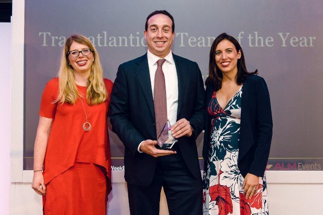 two woman and man with Team of the Year Award