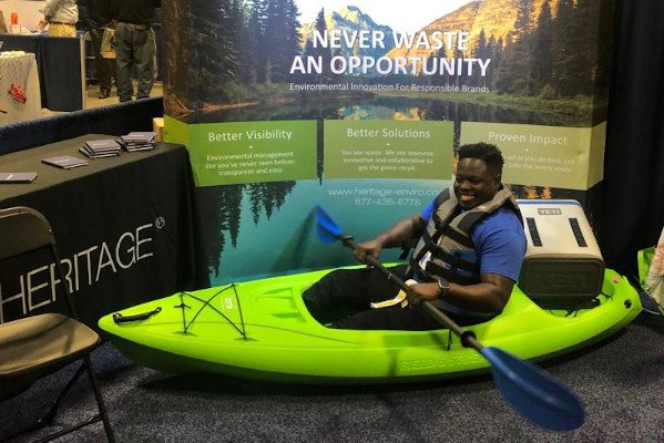 Man in kayak respresenting Heritage Conference Booth