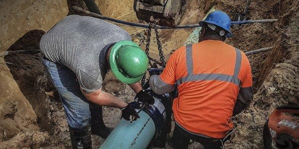 men repairing a water main